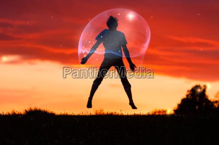 boy in a bubble jumping in