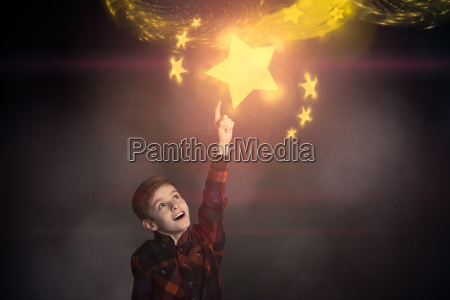 cute boy touching a glowing yellow