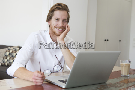 young man sitting in living room