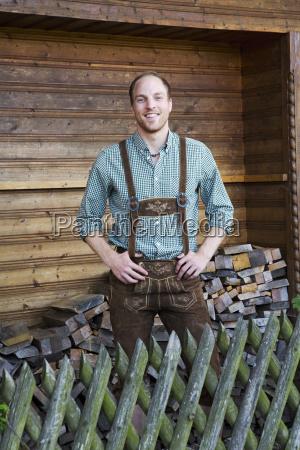 young man in bavarian lederhosen in