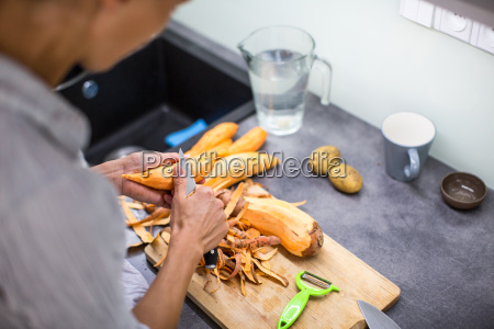 young woman cooking in her modern