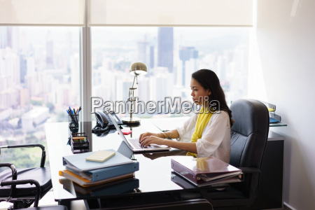 business woman secretary typing on laptop