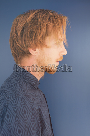 side profile of red haired young