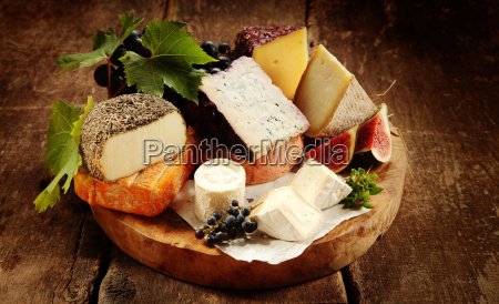 gourmet cheese platter on a rustic