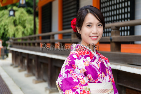 young woman with kimono dress at