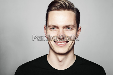 young handsome man smiling to you