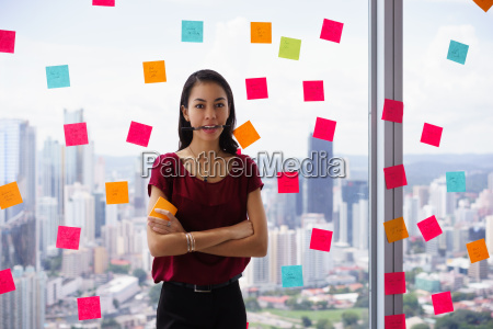 busy business woman with pen in