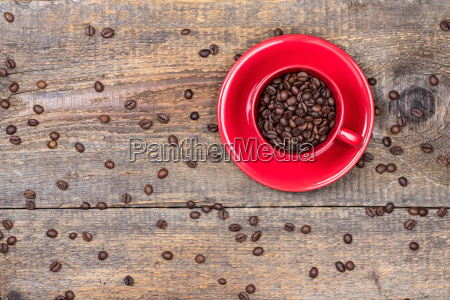 coffee beans in red cup