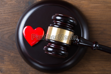 mallet and heart on table in