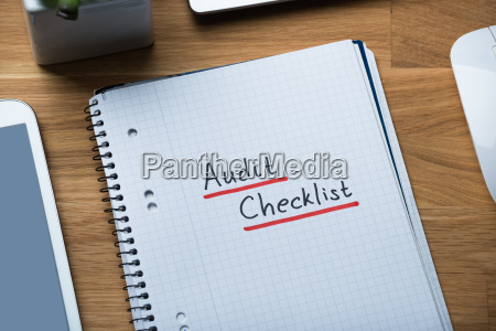 audit checklist written on notepad at