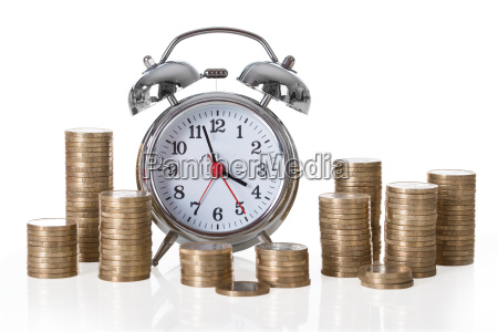 alarm clock and coin stacks