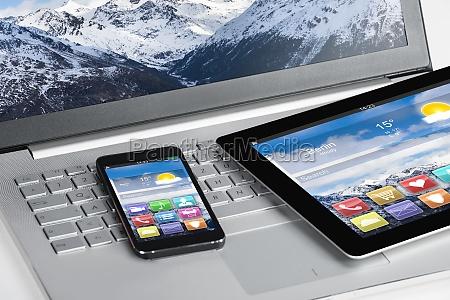 digital tablet and smartphones on laptop