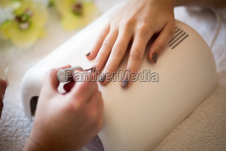 woman with nail care