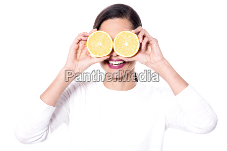 woman covering her eyes with halved