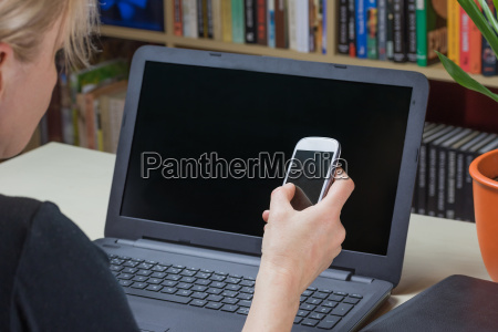 woman is holding a smart phone