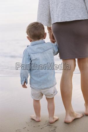 woman standing on a sandy beach