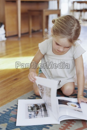 young girl sitting on the floor