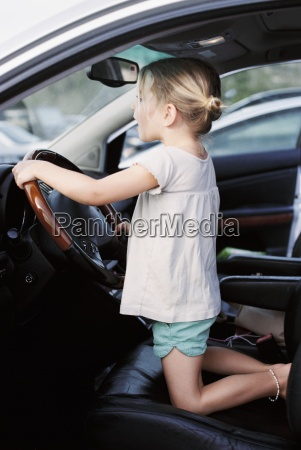 young girl kneeling on the drivers