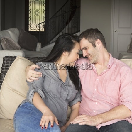 smiling man and woman sitting on