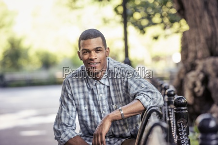 a man seated in a city