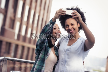 two women posing and taking a