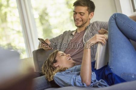 a couple a man checking his