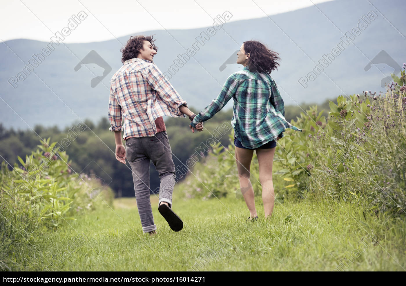 a, couple, , man, and, woman, running - 16014271