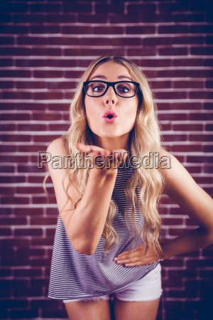 gorgeous blonde hipster blowing kiss to