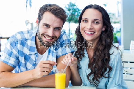 cute couple sitting in cafe