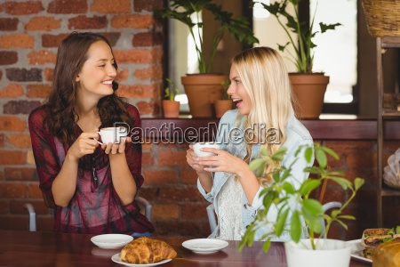 female friends having coffee at coffee