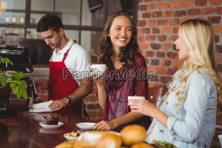 female friends having coffee at coffee