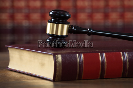 mallet on legal book in courtroom
