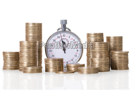 stopwatch and coin stacks
