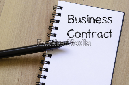 business contract write on notebook