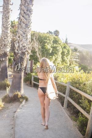 blond woman in a black bikini