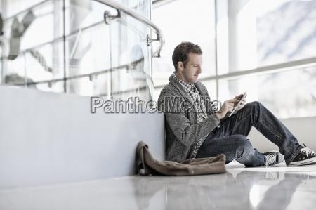 a man sitting down using a