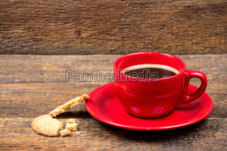 coffee cup with biscuit