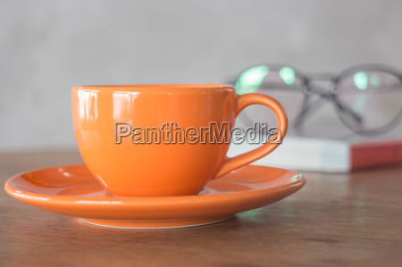orange mug cup of coffee
