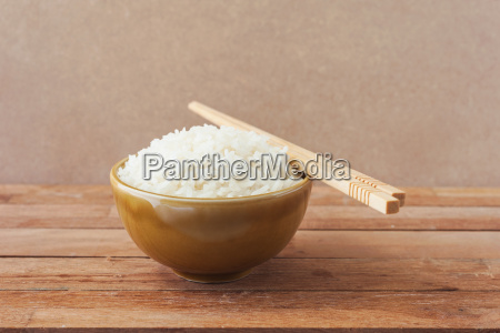 white rice in brown bowl with
