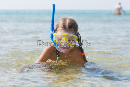 the girl emerged from the water