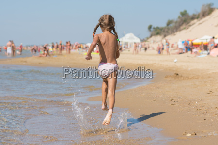 six year old girl running on