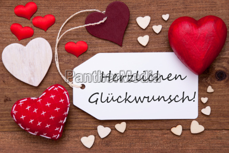 label with red hearts glueckwunsch means