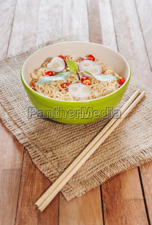 noodle in bowl on wooden background