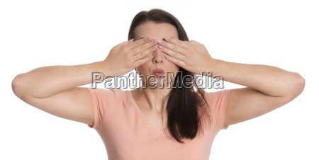 girl in portrait covering his eyes