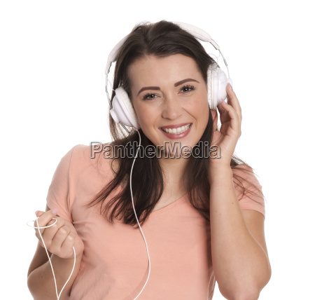 young woman with headphones smiling