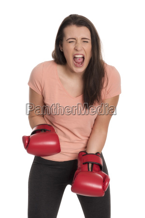 young woman with boxing gloves yelling
