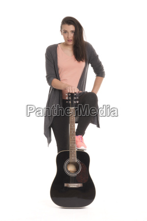 young woman holding an acoustic guitar