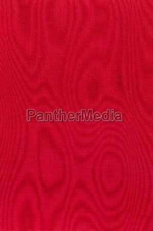 roter gewebter stoff mit moire