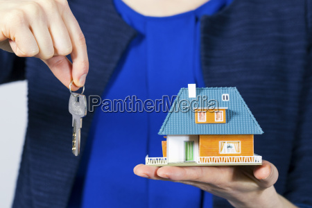 real estate agent with key and