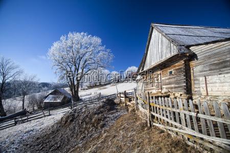 winter rural landscape with cottage on
